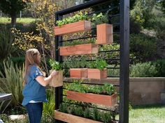 How to Make a Vertical Herb Garden From a Fence If your yard is short on space, go vertical with a garden wall made from a section of metal fence, basic lumber and redwood planter boxes.