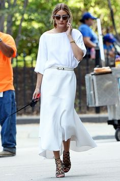 Olivia Palermo long white skirt and white top with belt via @WhoWhatWear