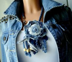 Original beautiful floral necklace in denim, jeans,unique handmade, decorated with pearl ,svarowski crystal,bieds, lace,denim cord, center of the flower is a new textile technology This jewelry highlights vibrant personality. It makes a great gift for her.  This necklace length is 17,3 inc [44cm]  Gift bag  Returns Policy: to receive full refund (excluding postal cost), item must be returned within 14 days of receipt, unworn as new with tags.  Customs charges may be applicable to Non-EU…