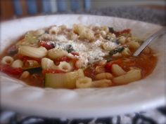 Janelle from Comfy In The Kitchen has done it again! She's back with a healthy dish for our families! Spinach, zucchini, onion, carrots, celery, bay leaves, chicken broth, thyme, diced tomatoes, navy beans, macaroni, garlic powder, Parmesan cheese, salt and pepper Rinse and drain beans In a large pot on medium heat, add beans, tomatoes and broth Dice onions, carrots and celery Take thyme off of stems and break off 2 bay leaves. Add bay leaves, thyme, onion, carrots, celery, salt, pepper…