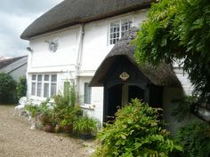 Little Thatch sleeps people in 1 bedroom with a double sofa bed in the lounge. It has a front and back entrance, both with lovely thatched porches. All the rooms are on the ground floor so it might suit anyone who is partly disabled. Large Round Dining Table, Inglenook Fireplace, Short Break, New Forest, Back Doors, Dining Table Chairs, Ground Floor, Sofa Bed, Porches