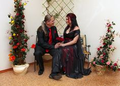 gothic bride and gromm are taking picturers