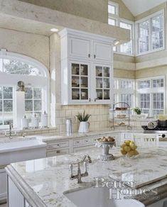 White kitchen with wonderful windows...