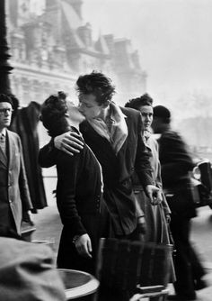 The Kiss photographed by Robert Doisneau, France, 1950.
