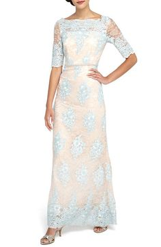 Vintage Elegance: When searching for classic mother of the bride dresses, you should also consider the theme or color palette for the occasion. This vintage-inspired peach and blue dress would fit right in at a garden wedding or an event with a muted color scheme.