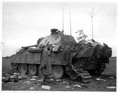 An American soldier walks by a destroyed German Befehlspanther or command Panther in France August 1944. The wrecks of various Panzers including Tiger and Panther tanks were all over Normandy despite the various post-war hype over their superior design. The reality is the Armored Korps of both the Waffen-SS and Wehrmacht were reduced to pieces by Allied Forces who solidly beat them in supposedly inferior tanks.