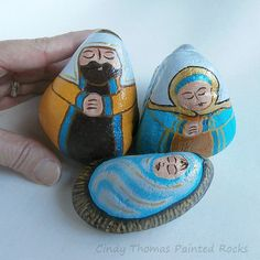 Nativity set painted on rocks in gold, aqua, brown hues with metallic accents