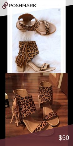 Leopard Cheetah heels firing size 9 A beautiful pair of leopard/cheetah heels with fringe.  These beauties have never been worn and are still in the box.  Size 9 Shoes Heels