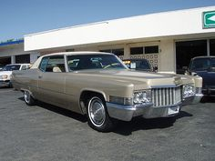 1970 Coupe DeVille - my mom's was a 70 something...i think a 76...but it was kind of a brass/goldish color! Beautiful car...i simply fell in love with old Cadillacs after that :)