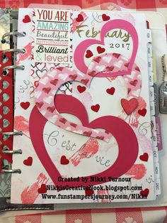 February Monthly planner cover with interlinking hearts and color splash stamped background using Fun Stampers Journey papers and dies.