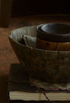 serve the food out of used, worn wooden bowls, each one different and adding loads of warmth to the table