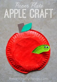 Paper Plate Apple Craft with an adorable worm sticking out of it. Perfect Fall or back to school craft for kids.