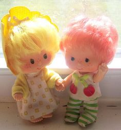 Butter Cookie & Cherry Tart.  The baby Strawberry Shortcake dolls came with pets, I think.