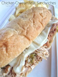 Slow Cooker Chicken Cheesesteak Sandwiches - Together as Family