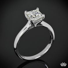 """Slender and elegant, the """"Caroline"""" Solitaire Engagement Ring for Princess Cut Diamonds by Vatche is sure to dazzle your beloved.  The delicate 4 prong head is surrounded by 16 surprise Round-Ideal Diamond Melee (0.05ctw"""
