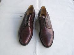 brown leather lace-up shoes. English style