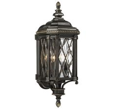 A stately outdoor lighting look is yours with The Great Outdoors Bexley Manor. Features clear glass, a lattice pattern, braided rope details…