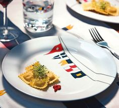 Nautical outdoor dinner plates with flag design: http://www.completely-coastal.com/2014/04/coastal-nautical-melamine-plates-outdoor-entertaining.html This is outdoor dinnerware made from sturdy melamine.