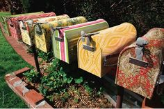 cute mail boxes covered with wall paper..