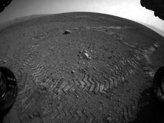 This image shows the tracks left by NASA's Curiosity rover on Aug. 22, 2012, as it completed its first test drive on Mars The rover went forward 15 feet (4.5 meters), rotated 120 degrees and then reversed 8.2 feet (2.5 meters). Curiosity is now 20 feet (6 meters) from its landing site, named Bradbury Landing.