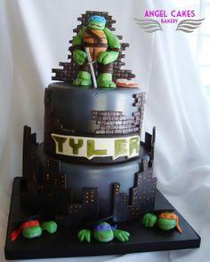 - Teenage Mutant Ninja Turtles themed cake.  Skyline is bricks are modeling chocolate, Turtles are fondant/gumpaste
