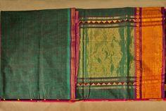 Single green coloured saree with golden border.