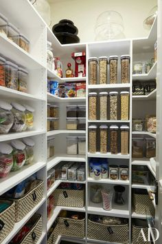 Khloe Kardashian - Super organized kitchen pantry boasts white modular shelves filled with plastic bins and woven baskets. Khloé and Kourtney Kardashian Realize Their Dream Houses in California Photos Architectural Digest Khloe Kardashian pantry Note: ad Pantry Organisation, Pantry Storage, Kitchen Organization, Kitchen Storage, Organized Pantry, Pantry Diy, Food Storage, Pantry Shelving, Storage Ideas