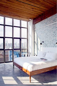 Wythe Hotel Brooklyn: The custom beds at Brooklyn's Wythe Hotel, a converted former textile factory originally built in 1901, are designed by Dave Hollier Woodwork and Design, using reclaimed ceiling timbers. The rooms pay homage to the building's Old-World industrial roots with a clever modern twist. Graphic wallpaper, distinctive wood furnishings, and a brisk color palette lend an air of pure sophistication.