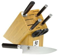 Shun Classic 7-Piece Block Set with Bamboo Block by Shun. $599.95. 8-inch chef's knife, 9-inch bread knife, 3-1/2-inch paring knife, 6-inch utility knife, sharpening steel, Taskmaster shears, 11-slot bamboo block. VG-10 high-carbon stainless-steel blades with 16 layers of stainless alloy for Damascus look. lifetime warranty; made in Japan. Black laminated PakkaWood handle with D-shaped profile for comfortable grip. One-piece stainless steel bolster, tang, and end-cap. Seamless st...