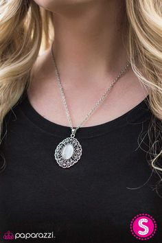 BIG FREEZE - SILVER NECKLACE ($5) Sprinkled with shiny accents, silver filigree swirls into a frilly frame. A silver moonstone dots the center of the pendant, adding a colorful finish to the icy palette. Features an adjustable clasp closure. Includes a pair of free matching earrings.