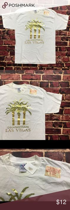 Vintage Las Vegas Gold Foil Palm Tree Tee Shirt Vintage Deadstock NWT Las Vegas Gold Foil Print Shirt Mens Size Large in White *flaws*  New with tags but has some staining from storage. Shown in photos. Has not been washed since tags are still attached.   See Photos.  Plenty of other items for sale & always listing more! Be sure to check out my store & give me a follow Shirts Tees - Short Sleeve