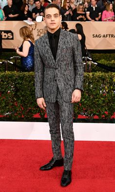 Malek was by far the most fashion-forward male risk-taker on the carpet in his houndstooth black and gray Dior Homme suit with hand embroidered red stitches.