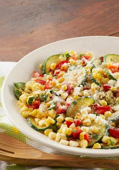 Farmer's Market Corn Toss -- This healthy living skillet recipe celebrates the flavors of fresh seasonal ingredients like corn and zucchini--ready for the dinner table in less than 30 minutes.