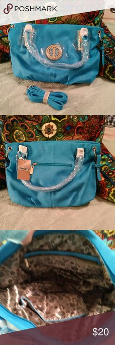 Chacal Taylor Turquoise Handbag Brand new, still wrapped. This is a BIG bag, 16 x 10. Bright turquoise with gold hardware. Has an additional shoulder strap. It Does Not specify genuine leather. Chacal Taylor Bags Shoulder Bags