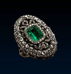 Louis XVI Style Ring, early 19th century, gold, silver, diamonds, emeralds,  Following the example of the Empress Eugénie in France who liked to surround herself with mementoes of court life during the reign of Louis XVI and Queen Marie Antoinette, fashionable women revived the jewellery styles of that period. In every way this emerald and diamond ring is typically Louis XVI.