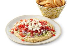 Chunky Vegetable Hummus Spread - I used Roasted Garlic Hummus, Red Peppers instead of Tomatoes and No Onion.  YUM!