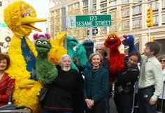 Puppeteer Caroll Spinney (L-R), Sesame Street co-founder and TV producer Joan Ganz Cooney, and Sesame Street cast members pose under a '123 Sesame Street' sign at the 'Sesame Street' on Nov. 9, 2009 in New York City. Photo by Astrid Stawiarz/Getty Images