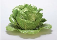A PAIR OF GREEN-GLAZED POTTERY CABBAGE-FORM TUREENS AND COVERS AND AN UNDERPLATE, 3,600.00, christies 2006.