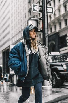 Mira Duma. Puffer jacket, sweatshirt, dad hat and leggings for the ultimate winter outfit