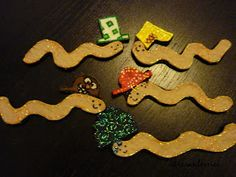 Five little worms flannel board or stick puppets. Use with worm lessons.