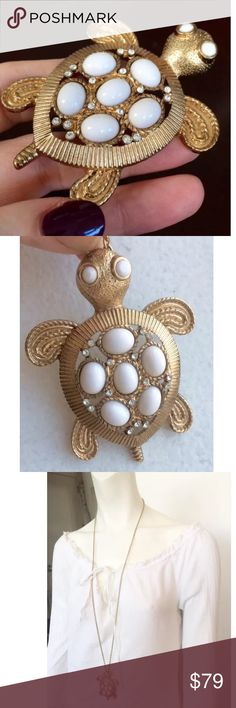 "8/11 HPFRI FLASH HP SALE✨1960s TURTLE NECKLACE ✨LAST NITE'S HOST PICK❤️  FABULOUS TURTLE STATEMENT NECKLACE! I can not find any hallmarks. I was told from the 60's. Cool VINTAGE piece. Gold throughout- Beautiful like new condition!    • Luminous Gold finish • Inset 3D white Bakelite/lucite(?) dome shell, rope edges, ribbed details galore! • 16 Swarovski Crystals add Sparkle • Elegant design has impact • Long Chain adjust to suit outfit   Size: Large Turtle 2 3/4"" x 2 1/4"". Long Chain 36""-38""…"