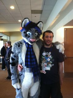 Great fursuit, love the natural colors with the blue and black scarf and hair! FCN 2013 photo from Stephanie Luettke.