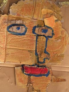 Cardboard scraps portrait with paint and crayon