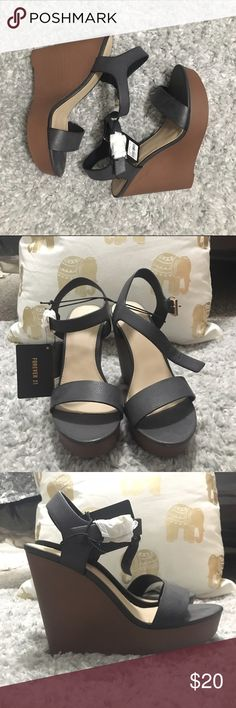 Brand new forever 21 wedges Black banding and dark brown heels. Never worn. Still have tags. Super cute for summer. Forever 21 Shoes Wedges
