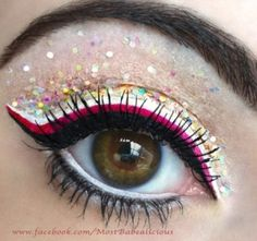 Dramatic pink and black liner with multicoloured glitter eye make up