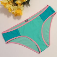NWT Swim Hipster by aerie Brand New with Tag & Protective Hygienic Swimwear Liner.  Swim Hipster Sz Medium from aerie.  Light & Dark Turquoise with a Pink Trim.  Very Pretty!  Top-Rated Seller.  Fast Shipper.  Bundle & Save.  15% Off two or more listings from my closet.  Thanks for Looking:) Happy Poshing! aerie Swim Bikinis