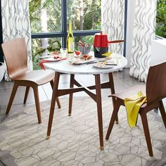 I love this little round table for my super small condo. Reeve Mid-Century Bistro Table | West Elm