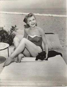Vera-Ellen with a black cat at the beach - so much to love about this great photo.
