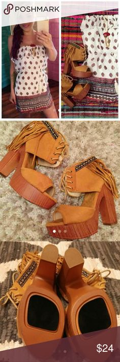 Fringe Chunk Boho Heels Size 6.5   These run true to size   Opened toed and open heel.  Heels is 5.5 inches tall.  Extremely comfortable with cushion comfort.  Don't forget to follow my closet for future listings. Thank you!  TAGS: Boho Bohemian fringe heels Coachella Minnetonka fringe. Fall heels. Comfy heels tan brown festival burning man Indian moccasins  🚫PP 🚫Trades 🚫Lowballers ✔Bundles ✔Negotiations ✔Poshmark Rules Mimi Chica Shoes Heels