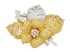 The floral and leafy design pave-set with round yellow diamonds weighing approximately 2.20 carats, and round diamonds weighing approximately 1.00 carat, mounted in 18k white and yellow gold